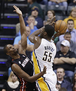 Roy Hibbert must use his size to tire Bosh and get him in foul trouble.